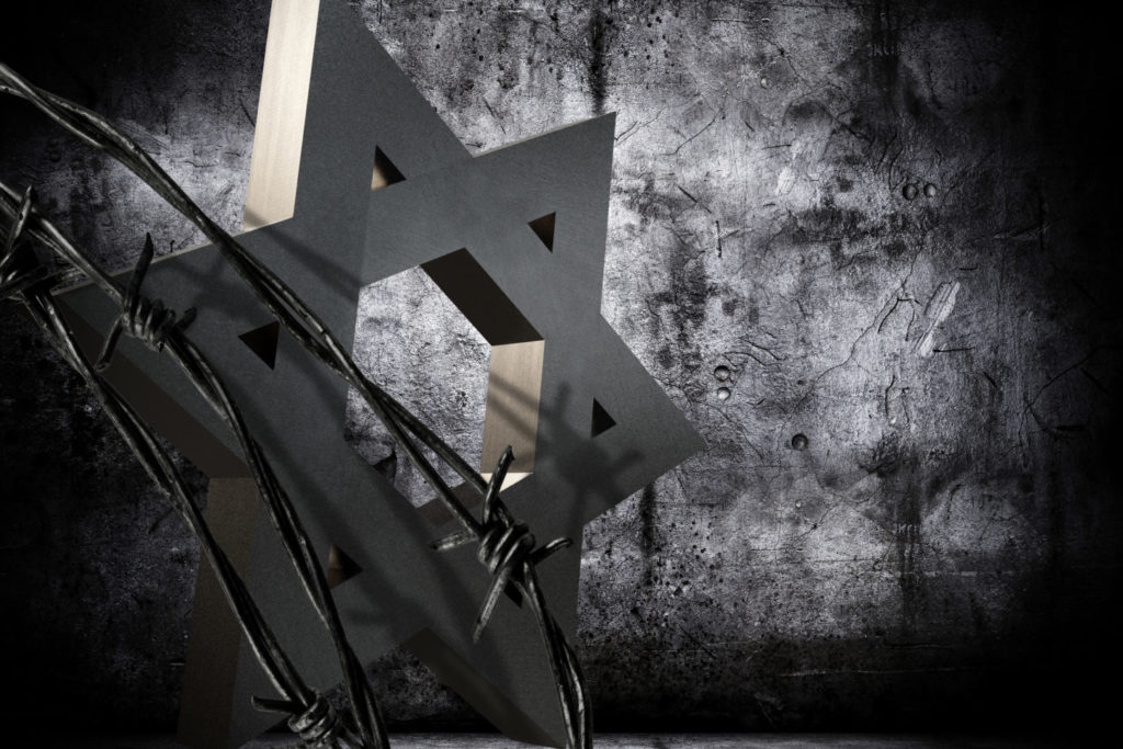 Conceptual background in memoriam of the Shoah Day, representing a granite star of David barbed wire.