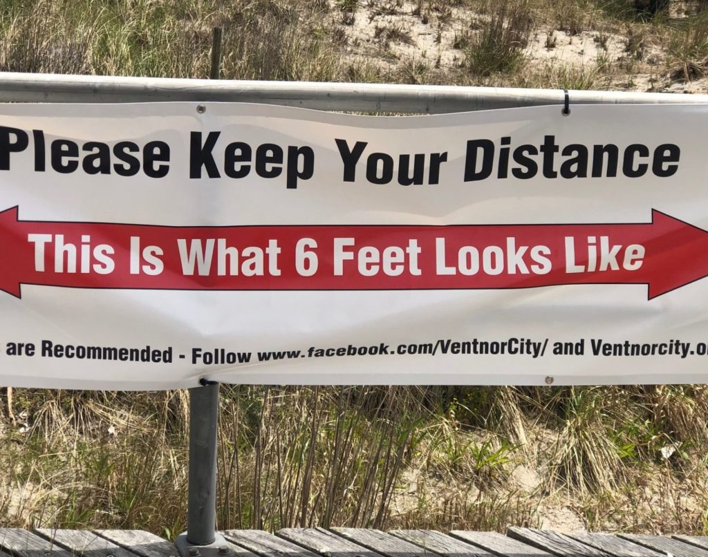 A Ventnor boardwalk sign reminds walkers, runners and strollers to social distance.