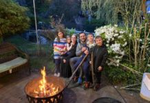 The Spinka family cozies up for a bonfire. From left: Tehilla, Sara, Devora, Yoni, Shua and Avrami Spinka