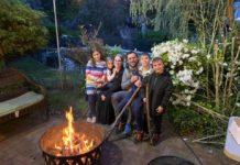 The Spinka family cozies up for a bonfire. From left: Tehilla, Sara, Devora, Yoni, Shua and Avrami Spinka