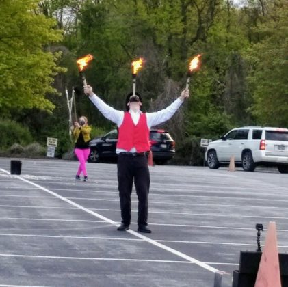 At Har Zion Temple, Meadow Perry (bubbles) and Dave Darwin (fire), entertainers with David Zeidman Entertainment, wowed the crowd of onlookers in their cars.