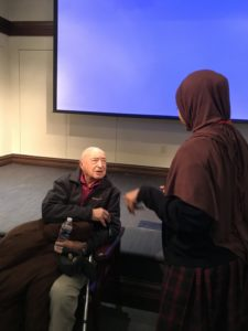 A student asks questions after a January youth symposium on the Holocaust presentation by Holocaust survivor Marius Gherovici.