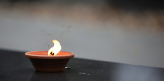 stock photo of candle on gravesite