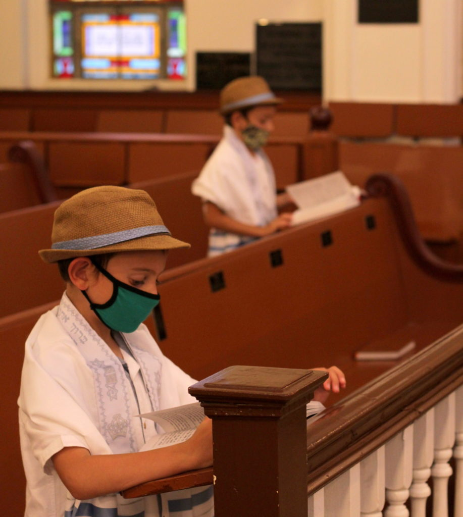 boys in masks in synagogue sanctuary
