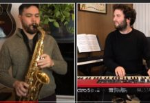 one guy playing sax, one guy on keyboard