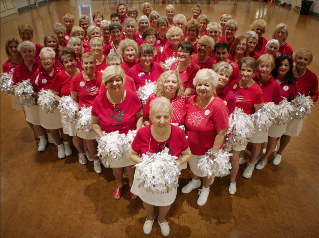 group of older women in cheerleading outfits
