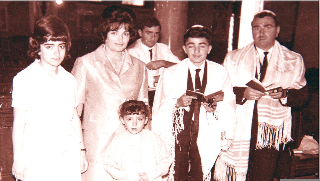 family celebrates bar mitzvah