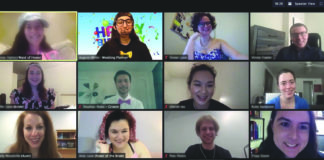 Twelve smiling people on a Zoom call